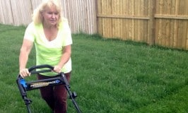 green girl cutting grass